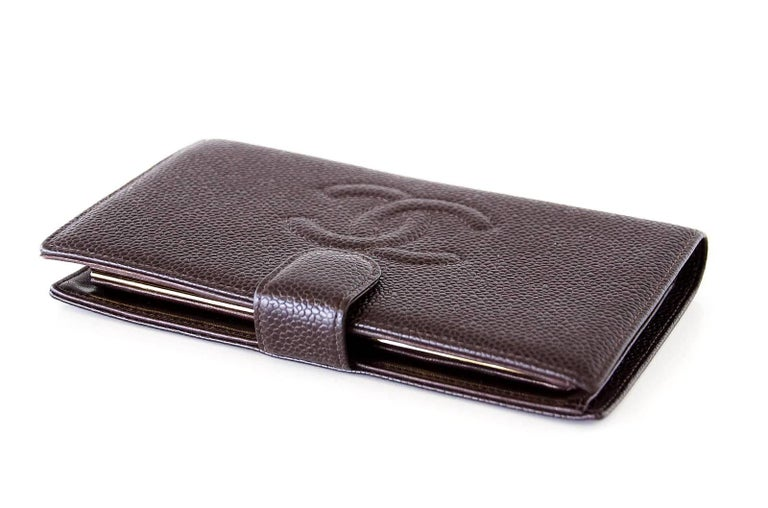 1f378fe9519c15 Guaranteed authentic Chanel vintage long bifold brown caviar leather wallet.  Front CC embossed logo.