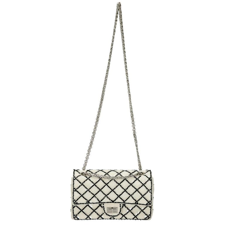 An eye-catching, posh and elegant bag coming from Chanel that you'll love to flaunt at your parties. Crafted from white mesh and adorned with sequins all over the quilted pattern, this bag is a refreshing version of the classic Reissue 2.55 that we