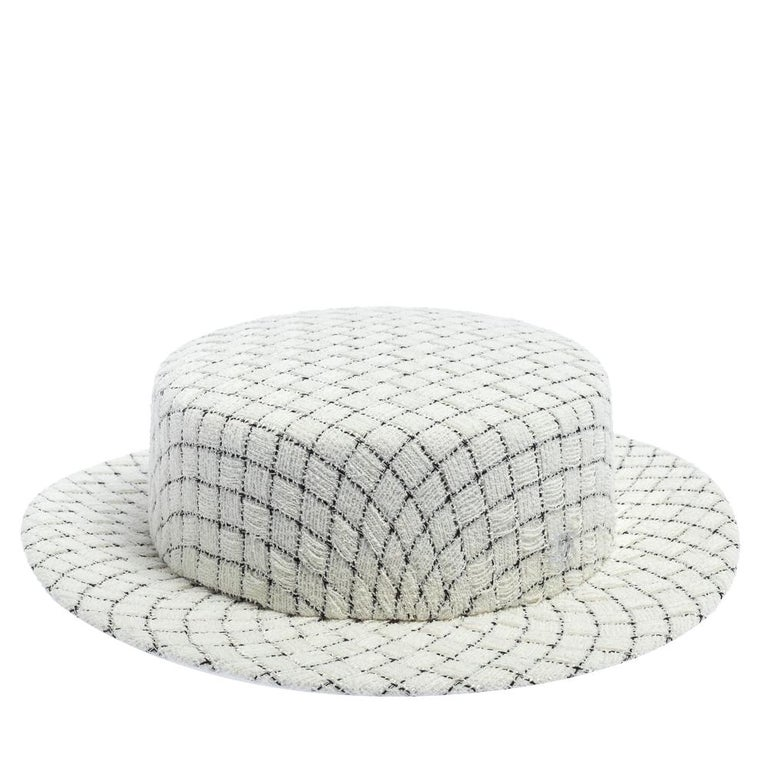 Chanel's take on the timeless Boater hat is impeccable. The tweed hat in white has a checked design all over. The style goes well with your resort and holiday looks.  Includes: Original Box