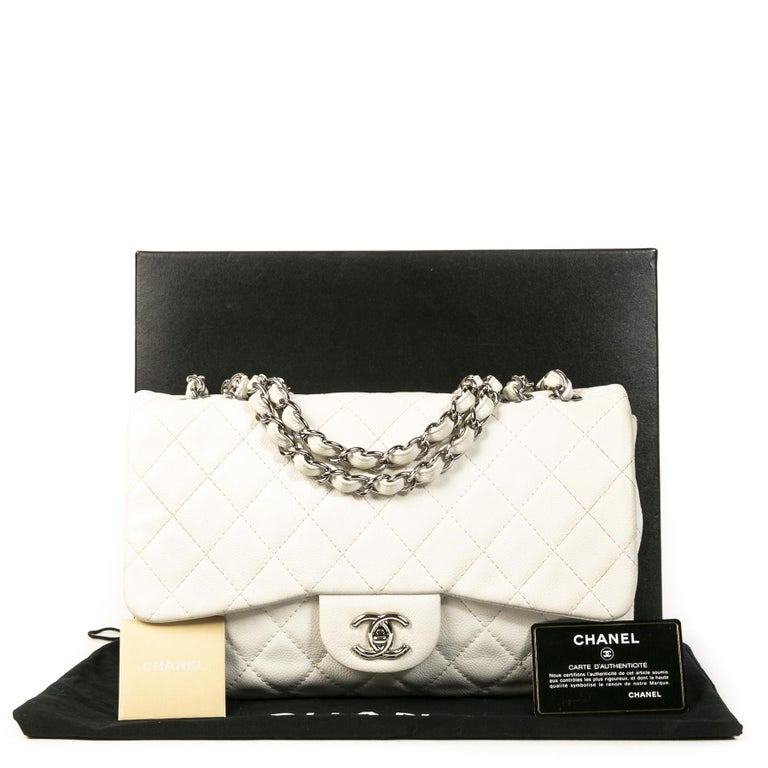 Good preloved condition  Chanel White Leather Jumbo Classic Flap Bag  The most wanted and iconic bag in the word, the classic Chanel Classic Flap Bag. This jumbo sized Flap Bag is beautifully crafted in white caviar leather and features classy