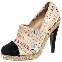 Chanel White Logo Printed Canvas And Black Cap Toe Espadrilles Clogs Size 38.5