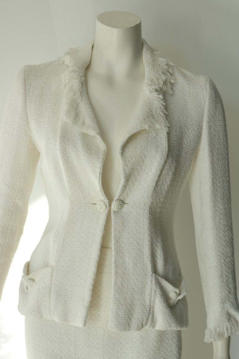 Stunning and classy Chanel skirt suit.  The tweed is white with silver detail. Size 40 Made in France