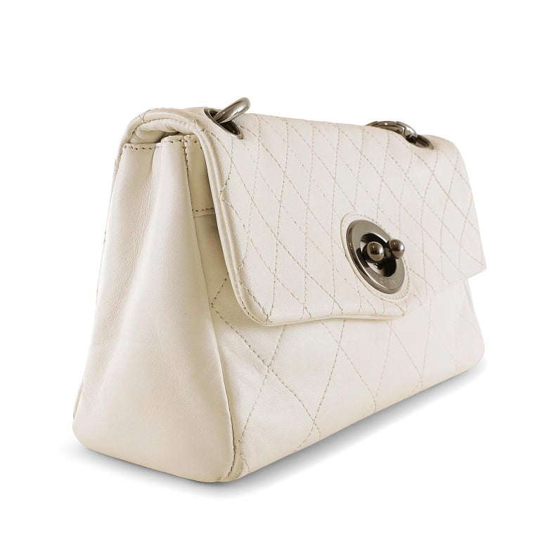 Chanel White Leather Flap Bag- excellent condition Easily transitioning from day to evening, it complements any ensemble. Creamy white leather is topstitched in signature Chanel diamond pattern.  Unique oval clasp in gleaming gunmetal hardware.