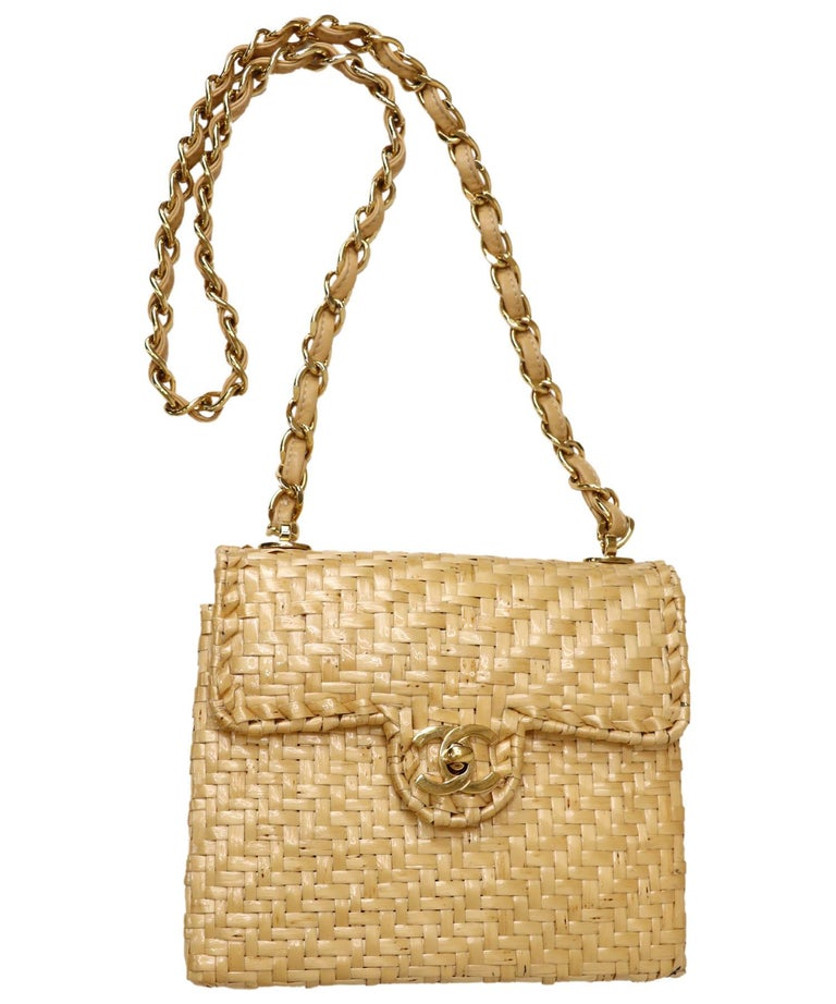 What a fabulous find! This rare vintage tan Chanel wicker shoulder or short crossbody bag is small and square in shape and has a 24k gold plated CC Turnlock closure at the front. The bag and flap are both structured. Flap opens to a hinged interior