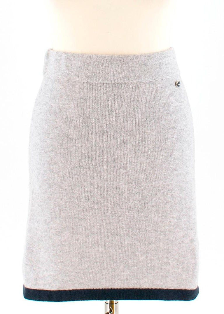 Chanel wool & cashmere two piece skirt & top  - Dove-grey, mid-weight knit wool and cashmere-blend  - Soft-touch two piece  - Top: roll neck, 3/4 length raglan sleeves, turn-up cuffs, navy ribbed-knit edges, slanted slip pockets, wrap-effect design,