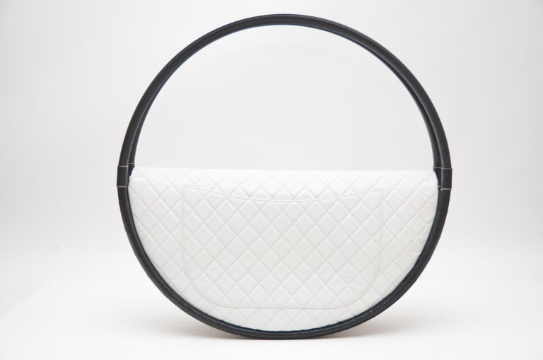 Chanel Hula Hoop  X Large size bag. Collector's  or decor piece  . When this bag hit the runways in 2013 it was most talked about  that season.It was   Quilted  pure white color  lambskin leather with 2 black hula circles covered with fine