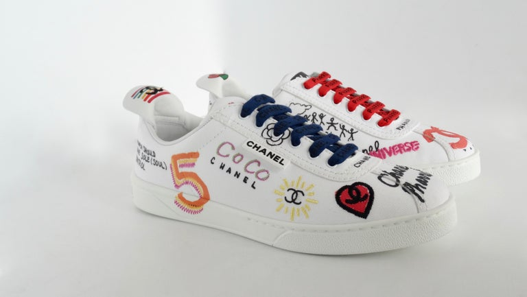 Women's or Men's Chanel X Pharrell 2019 White Graffiti Low Top Lace-Up Sneaker For Sale