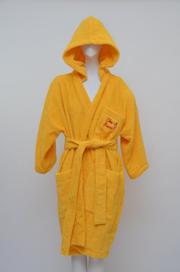 Chanel x Pharrell Capsule Collection  Bathrobe saffron color with  Lesage Embroidery   An urban capsule collection highlighting Pharrell Williams' longterm relationship with the House of Chanel and initiated by Karl Lagerfeld.  Each piece was hand
