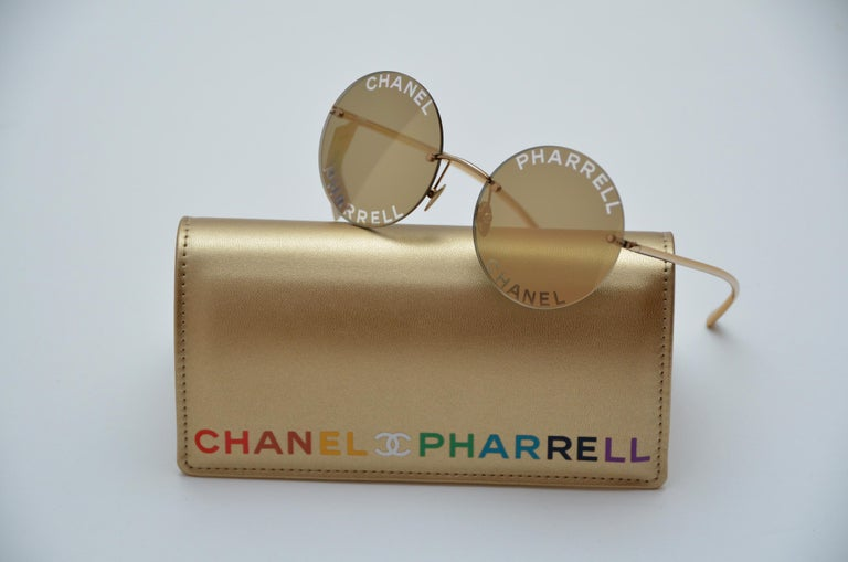 100% guaranteed authentic Chanel x Pharrell Capsule Collection Sunglasses .   An urban capsule collection highlighting Pharrell Williams' longterm relationship with the House of Chanel and initiated by Karl Lagerfeld .   Color : Gold reflective  and