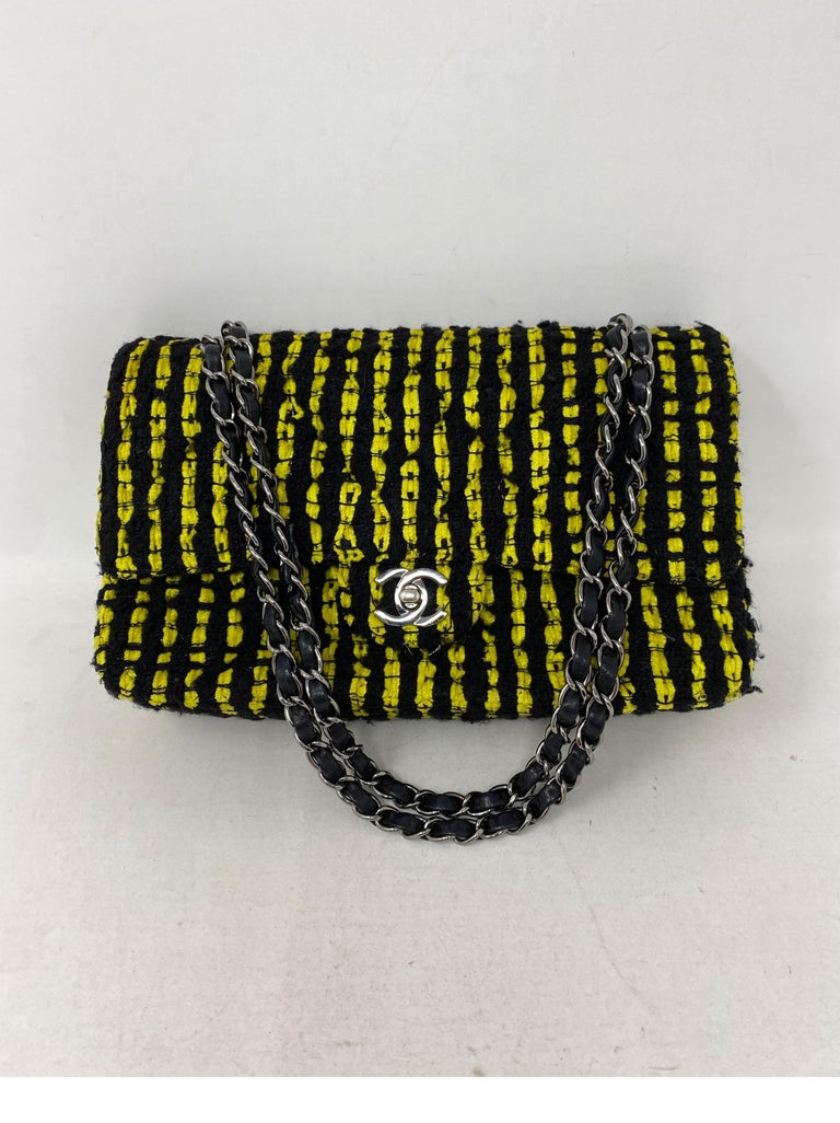 Chanel Yellow and Black Tweed Bag. Double flap bag. Black leather interior. Mint like new condition. Rare and limited collection. Guaranteed authentic.