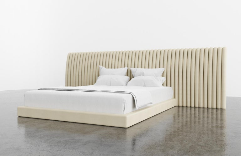 The Channel bed features a modern channeled upholstered headboard and matching upholstered frame. Available in King, Cali King, Queen or Twin sizes. Fully custom and made to order in California. As shown in Queen size in Kimodo Faux Leather/Cream