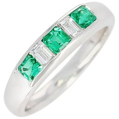 Channel-Set Invisible Emerald and Diamond Platinum Bridal Ring