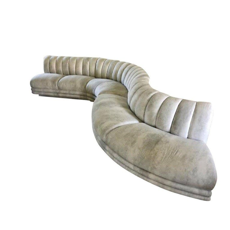A three part sectional sofa in a luxurious serpentine shape featuring a channeled back and channeled face.   Dimensions: Each section measures the following:   50L x 32D x 29H 65Lx 32D x 29H 82L x 32D x 29 H  Condition: New upholstery