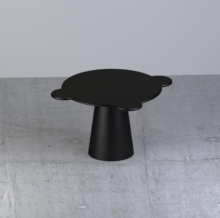 Donald is a multifunctional table with a sculpturally cosmic aspect and colorful circular shapes.