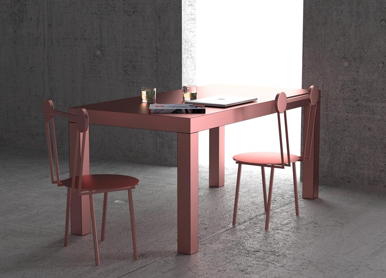 Hitan is a multifunctional table entirely covered by metal HPL Laminates.  Its Minimalist structure comprises a rectangular top supported by four square cross-section legs. The manufacturing process and research on metal surfaces treatment and