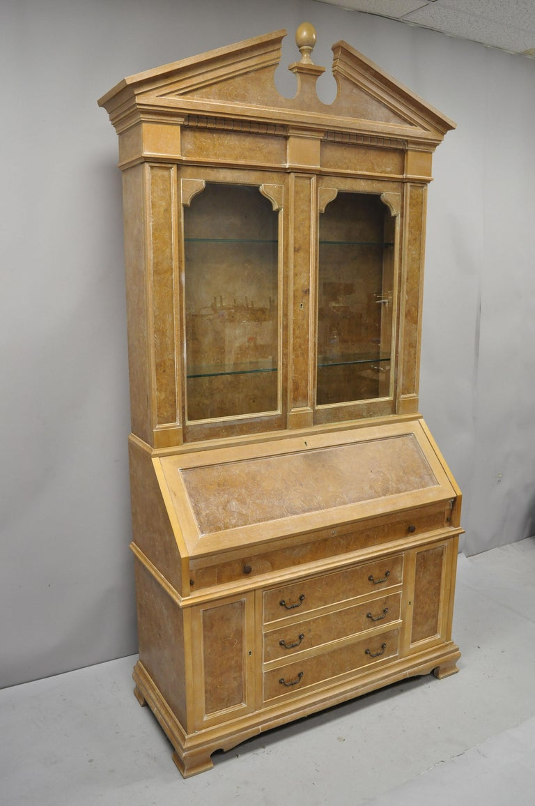 Chapman Italian neoclassical burl wood patchwork olivewood tall secretary desk. Item features 2 part construction, lighted interior with dimmer switch, 2 lower cabinet doors, 4 lower drawers, fitted interior, beautiful wood grain, original label,