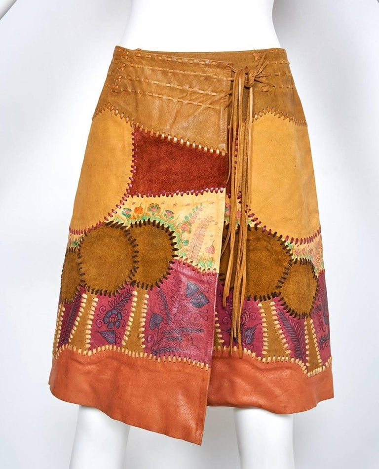 Made in Mexico by gifted artisans this hand painted and hand pieced wrap skirt has a scenic design of pieced trees and painted flower gardens. It is so beautifully made you could almost wear it wrong side out. The pieces are laced together and the