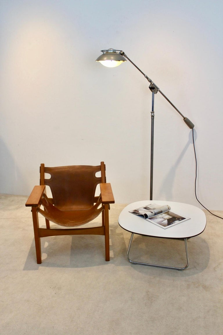 """Wonderful 'model 219S' floor lamp made by Louis Ferdinand Solère for Solere. This beauty was designed in 1950 and is also known as the """"light machine"""". This Industrial lamp has a telescopic arm and is adjustable in height. The lampshade has an"""