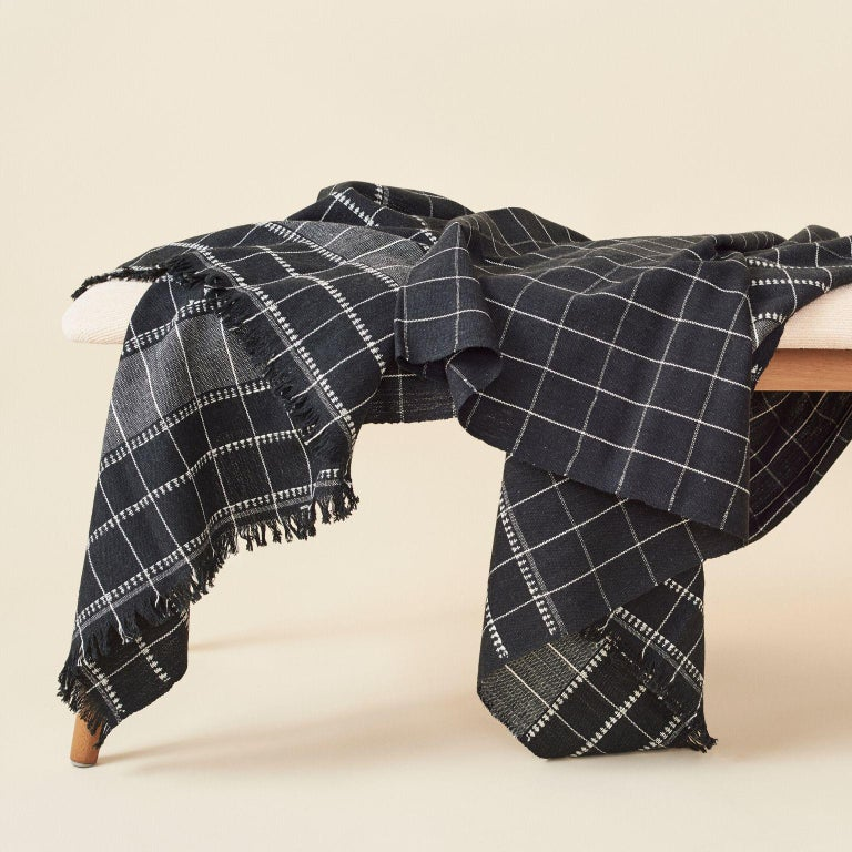Custom design by Studio Variously, Charco is a organic cotton throw / blanket is handwoven by master weavers in Nepal.  A sustainable design brand based out of Michigan, Studio Variously exclusively collaborates with artisan communities to restore