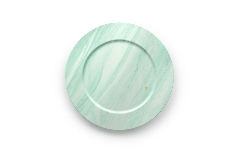 Hand carved charger plate from semi-precious green quartzite. Multiple use as charger plates, plates, platters and placers. Dimensions: D 33, H 1.9 cm.  Pieruga proudly creates elegant accessories and complements in marble through artisanal