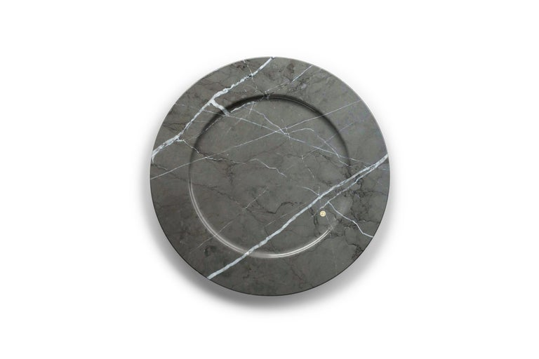 Hand carved charger plate from imperial grey marble. Multiple use as charger plates, plates, platters and placers. Dimensions: D 33, H 1.9 cm.  Pieruga proudly creates elegant accessories and complements in marble through artisanal processes,