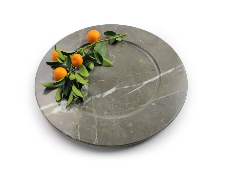 Set of 6 hand carved charger plates from imperial grey marble. Multiple use as charger plates, plates, platters and placers. Dimensions: D 33, H 1.9 cm.