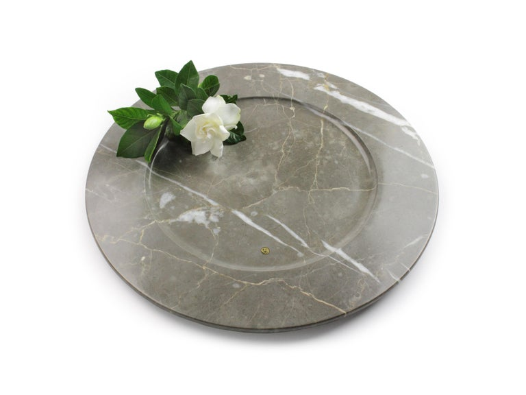 Set of 4 hand carved charger plates from imperial grey marble. Multiple use as charger plates, plates, platters and placers. Dimensions: D 33, H 1.9 cm.  Pieruga proudly creates elegant accessories and complements in marble through artisanal