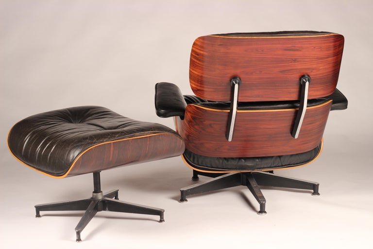 Charles and Ray Eames 670 Rosewood Lounge Chair and 671 Ottoman In Good Condition In London, GB