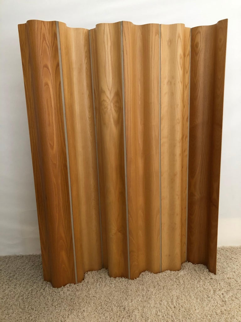 Charles and Ray Eames Iconic two sided molded plywood folding screen, appears to be two different shades of wood each side, shown in photos. Woven canvas in between 6 panels, FSW-6 in original very good fine condition. Very slight imperfections.