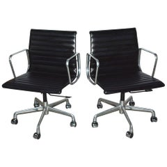 Charles and Ray Eames Black Leather Executive Armchairs, Sold Singly