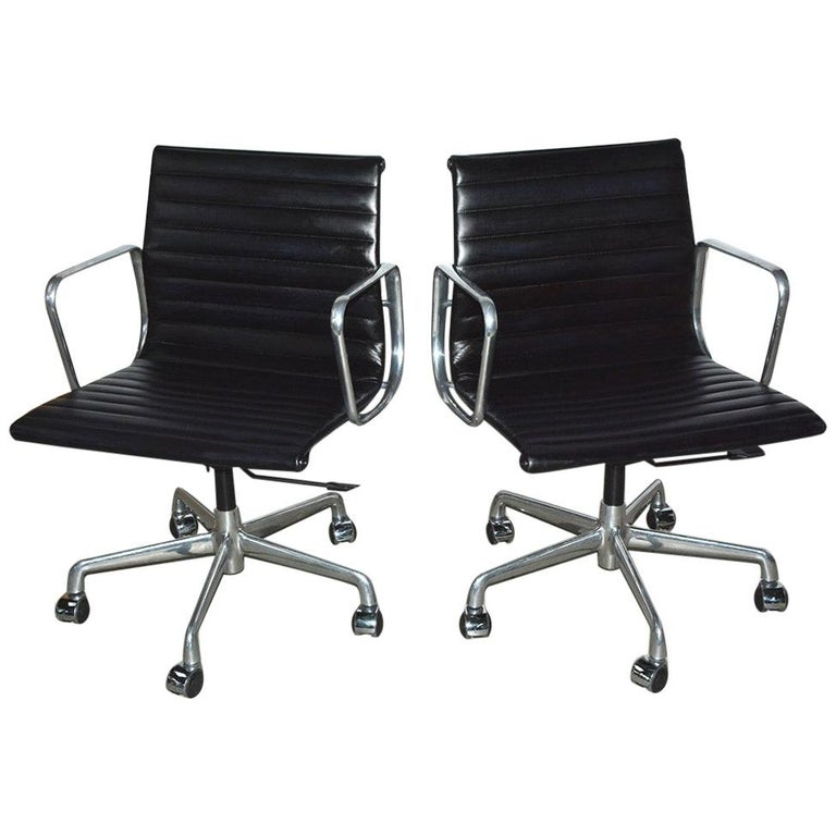 Charles and Ray Eames Black Leather Executive Armchairs, Sold Singly For Sale