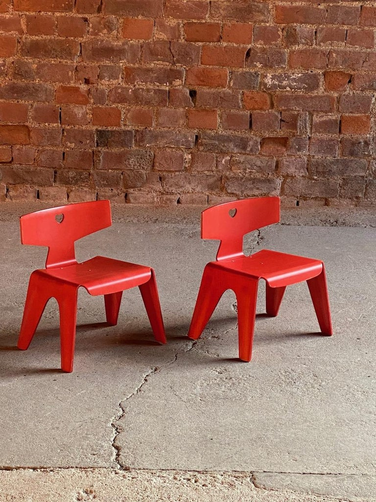 Charles and Ray Eames children's chairs, 2004  Super rare Charles and Ray Eames children's chairs originally designed in 1945, perfectly moulded birch wood construction, the backrests pierced with heart motifs, in red dyed finish with applied
