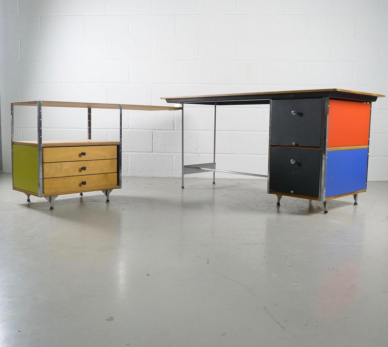 Charles and Ray Eames for Herman Miller, USA. An all original ESU desk and return. Birch ply tops, colored panels, original drawer pulls and boot glides. The shape can be changed by simply pivoting the return sections desired.  Second series