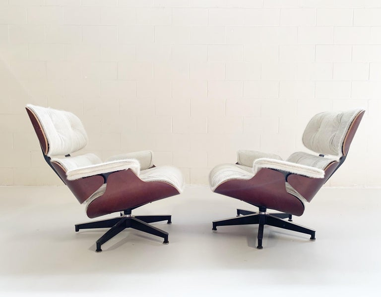 Mid-Century Modern Charles and Ray Eames for Herman Miller Chairs and Ottomans Restored in Cowhide For Sale