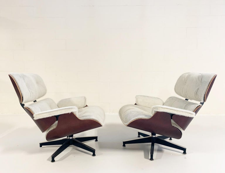 20th Century Charles and Ray Eames for Herman Miller Chairs and Ottomans Restored in Cowhide For Sale
