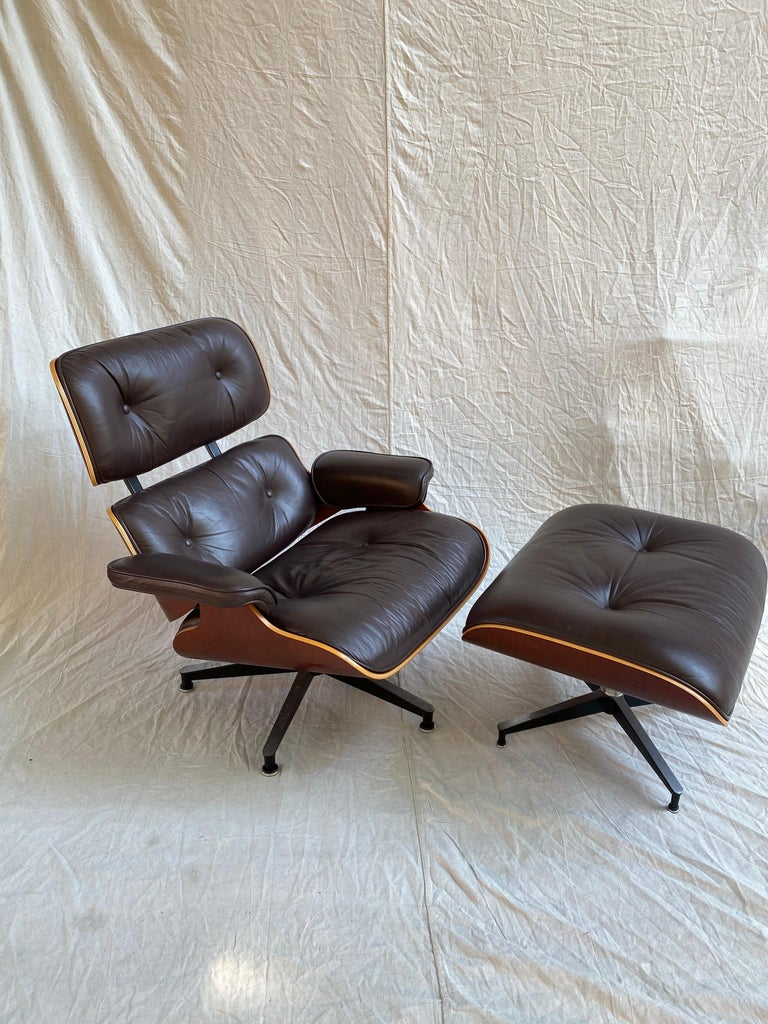 Classic Eames Design for Herman Miller! Cherry Outer shell, this chair dates to the mid-1990s. Cherry is in very good condition, showing no major wear. Leather is a deep wine or maroon. Shows minor patina to arms, but overall leather presents very