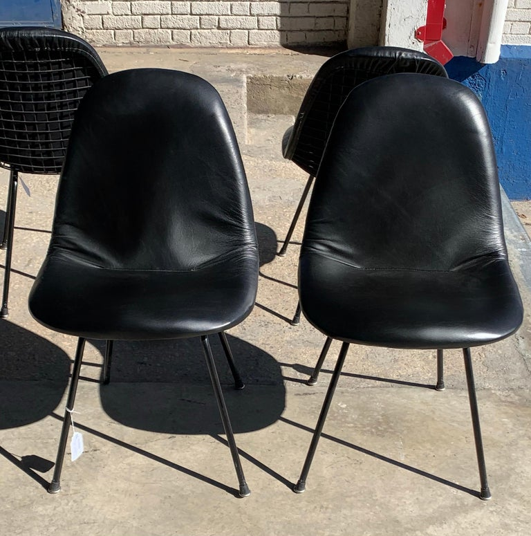 Charles and Ray Eames for Herman Miller DKX-1 chair, black leather, H-base, circa 1954, Boot glides   Pricing is per chair. Please change quantity to 4 to purchase entire set.  The abbreviated Eames DKX chair, part of the Wire Mesh Series,
