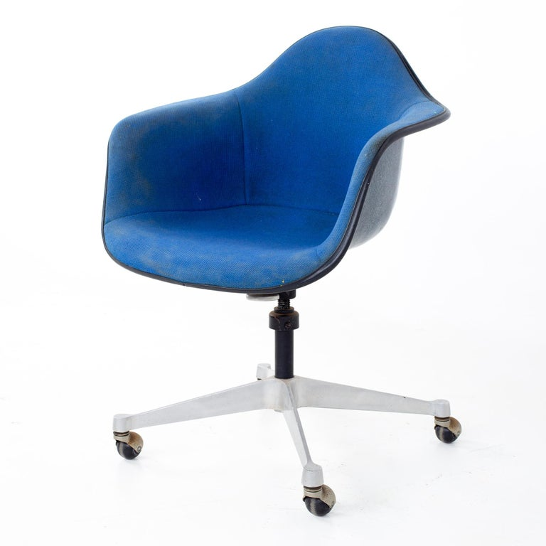 Charles and Ray Eames for Herman Miller mid century blue shell office chair Chair measures: 25 wide x 22 deep x 34 high, with a seat height of 18 and arm height of 27 inches  All pieces of furniture can be had in what we call restored vintage