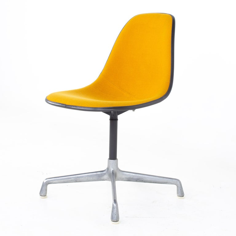 Charles and Ray Eames for Herman Miller mid century orange upholstered shell chair Chair measures: 18.25 wide x 26.5 deep x 32 high, with a seat height of 18 inches  All pieces of furniture can be had in what we call restored vintage condition.