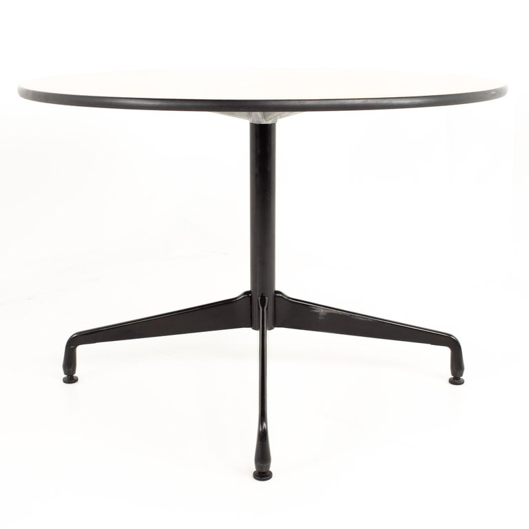 Charles and Ray Eames for Herman Miller Aluminum Group round wood and black dining  table   Measures: 41.75 wide x 41.75 deep x 28.75 high   This price includes getting this piece in what we call restored vintage condition. That means the piece is