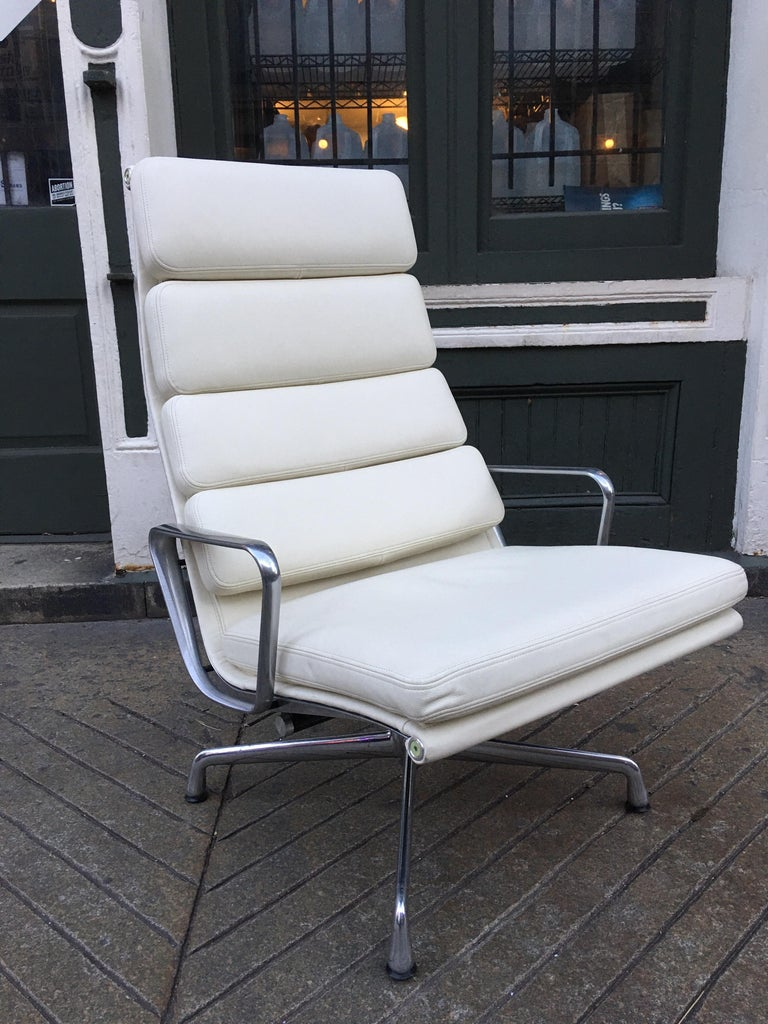 Charles and Ray Eames designed soft pad lounge chair in amazing condition! Bought for a space in 2013, but never installed! Leather is flawless! Aluminum arms are very clean, base shows minimal marks on one of the legs. Overall presents as new!