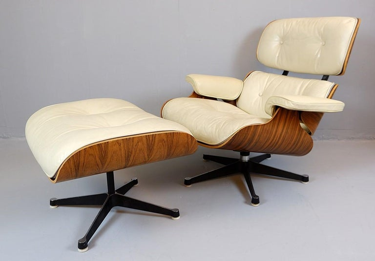 Charles and Ray Eames lounge chair and ottoman Mobilier International Edition  Measures of the ottoman in centimeters: 66 x 54 H 37 cm.