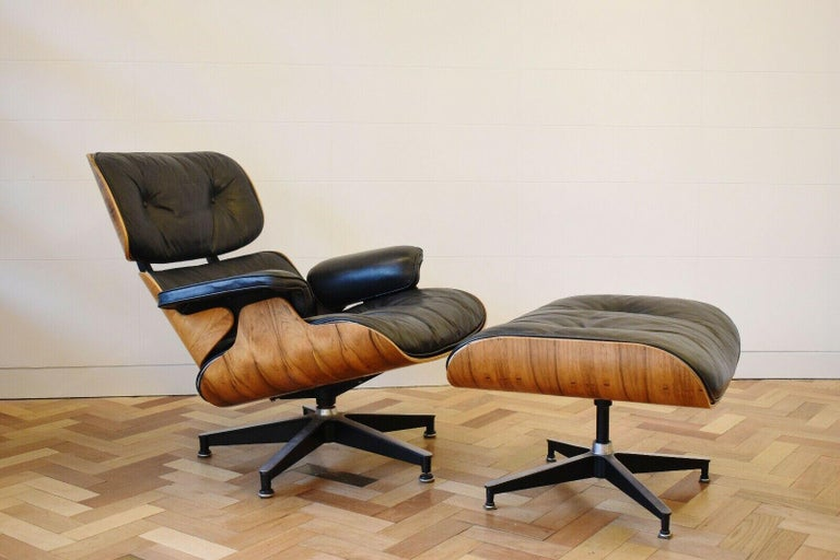 A superb Charles and Ray Eames, '670' lounge chair and '671' ottoman for Herman Miller, c.1970,  Both the chair and ottoman bares the 'Herman Miller' label to underside   This chair has rosewood a rosewood shell, with its original black leather