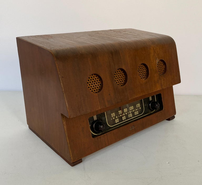 Radio of molded and cut walnut plywood, bakelite, glass and perforated masonite. Designed by Charles and Ray Eames and produced by Evans Products for Teletone, circa 1946. As Richard Wright noted in 2004,