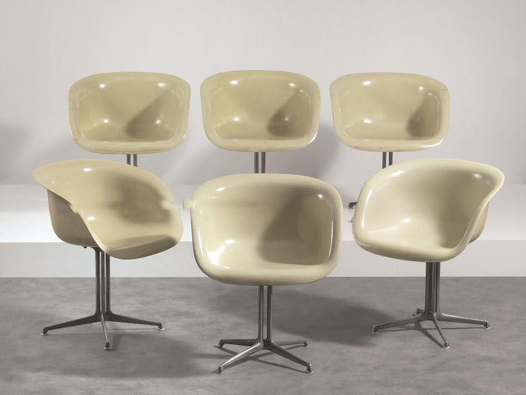 Set of six armchairs mod. La Fonda designed by Charles and Ray Eames for Herman Miller (1960). Structure in fibreglass and aluminium. Literature: M. Neuhart, The Story of Eames Furniture, Gestalten, Berlin, 2010, vol. 2, p. 708-712.