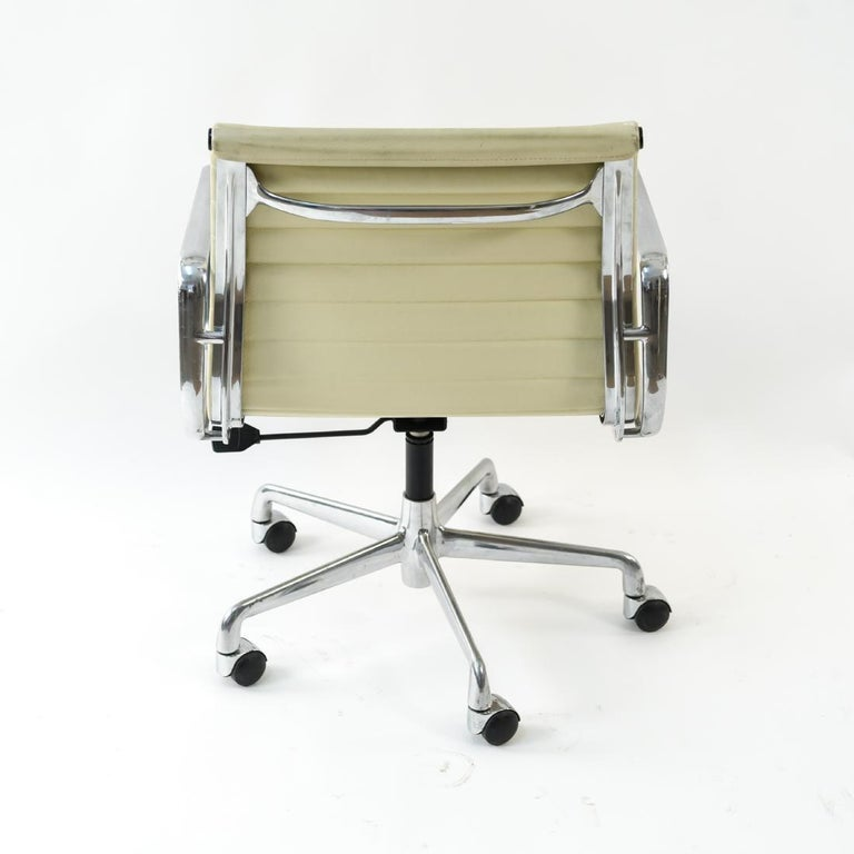 Aluminum Charles and Ray Eames White Leather Executive Armchairs, Sold Singly For Sale