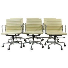 Charles and Ray Eames White Leather Executive Armchairs, Sold Singly