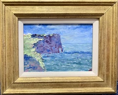 American Impressionist Coastal landscape with cliffs by the sea.