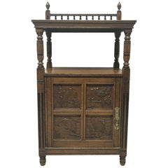 Charles Bevan, Gillows & Co. An Aesthetic Oak Cabinet with Carved Birds & Fish