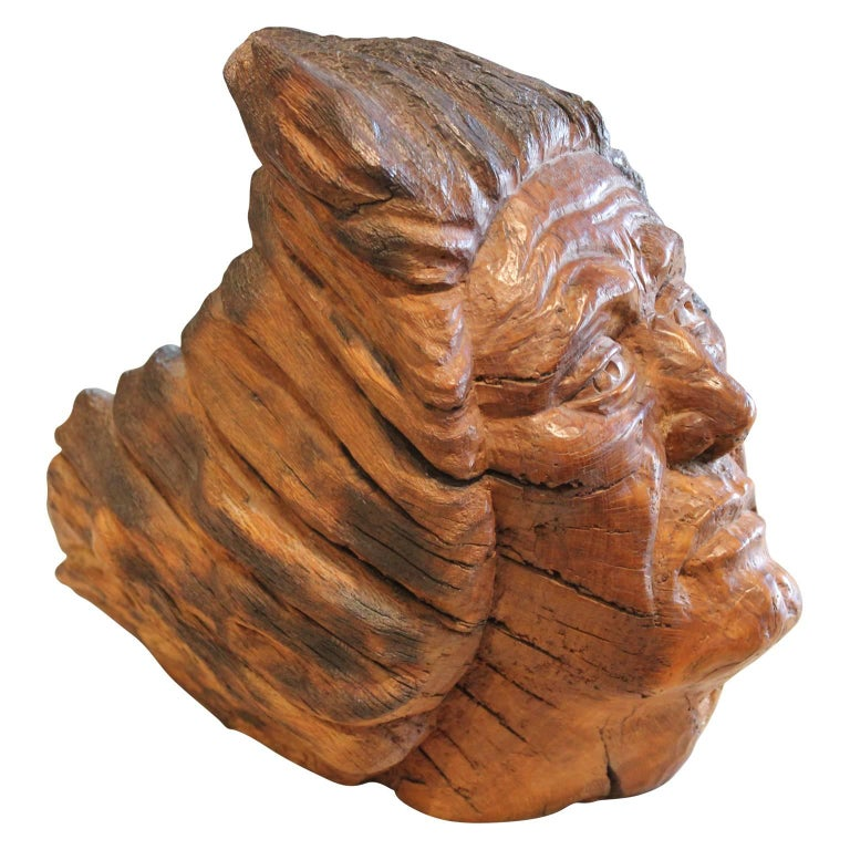 Carved walnut sculpture of an older man looking majestically off into the distance as his hair streams behind him by Texas artist Charlie Boren in the 1980's.   Artist biography:  Mr. Boren was born in 1927 in Snyder, Texas, to a pioneering family